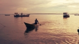 Fisheries boats at twilight on Lake Victoria.